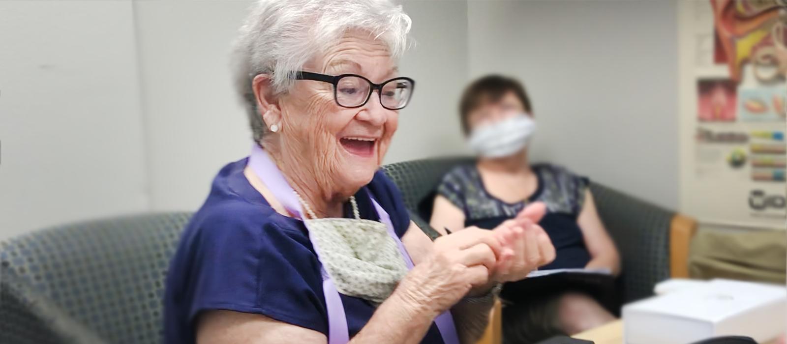 woman hearing aid happy - box header